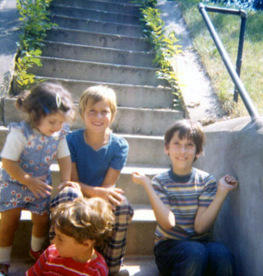 all four first cousins sitting outside on some steps in 1974 or 1975
