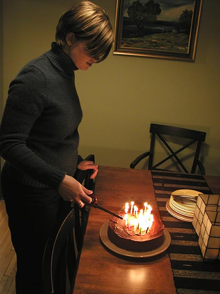 sarah lighting the candles on the cake
